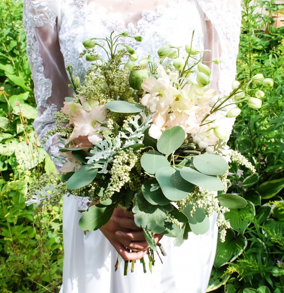 bouquet with English grown foliage, delphiniums, poppy seed pods, dusty miller