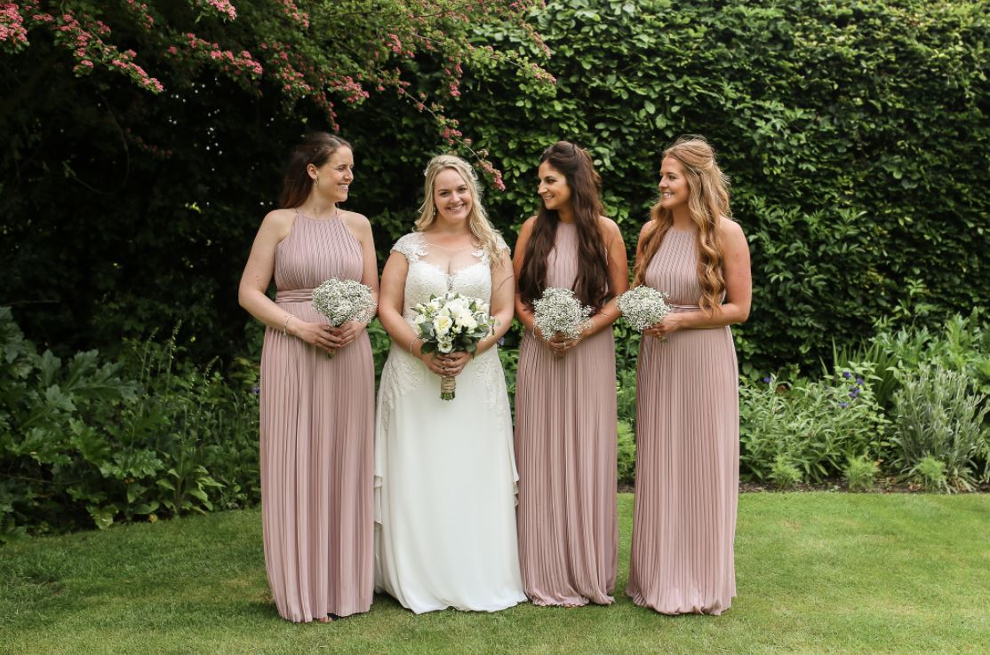bridesmaids in dusty pink