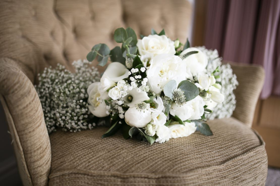 white flower and herb bouquet